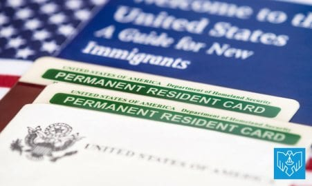 Two green cards and an american flag.